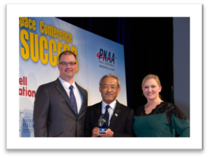 "Hitoshi ""Hank"" Iwasa, COO & Head of Moses Lake Flight Test Center, accepts the Inspire Award from PNAA on behalf of Mitsubishi."